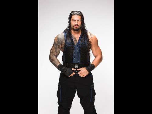 The Shield (WWE) wallpaper possibly containing an outerwear and a well dressed person entitled Roman Reigns