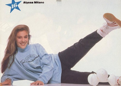 Alyssa Milano kertas dinding possibly with a sign titled Teen Pinup