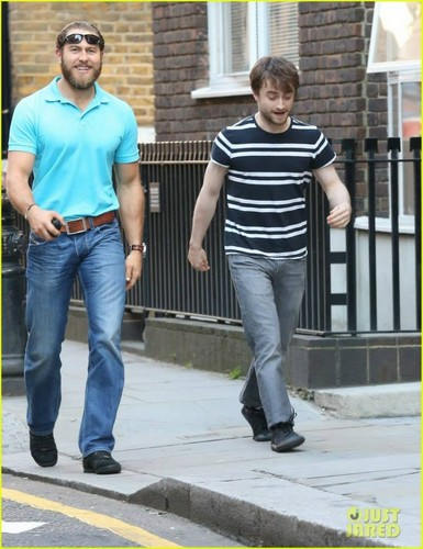 Daniel Radcliffe wolpeyper possibly containing a street, a business suit, and a hip boot titled Daniel Radcliffe With His Bodyguard (October 3) In London,Eng (Fb.com/DanielJacobRadcliffeFanClub)
