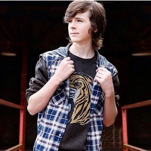 Chandler Riggs Hintergrund possibly with long trousers, an outerwear, and a playsuit, spielanzug titled HOT STUFF !!!!!!!