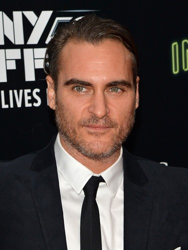 Joaquin Phoenix 壁紙 with a business suit, a suit, and a three piece suit called Joaquin Phoenix attends the Centerpiece Gala Presentation and World Premiere of 'Inherent Vice'