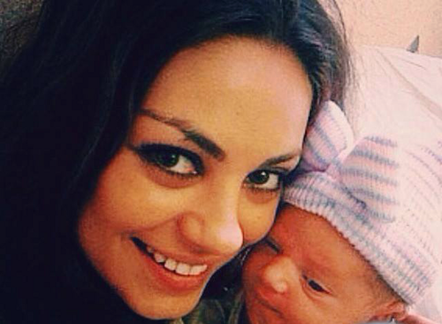 Mila Kunis Hintergrund with a neonate titled Mila Kunis