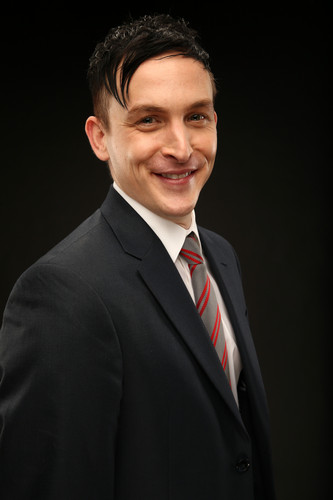 Gotham wallpaper with a business suit, a suit, and a single breasted suit called Robin Lord Taylor as Oswald Cobblepot