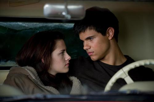 Jacob and Bella wallpaper probably containing an automobile entitled                 New Moon