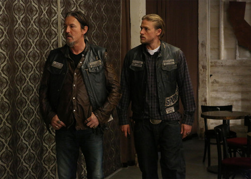 Sons Of Anarchy wallpaper with a chainlink fence titled 7x09 - What a Piece of Work Is Man - Chibs and Jax
