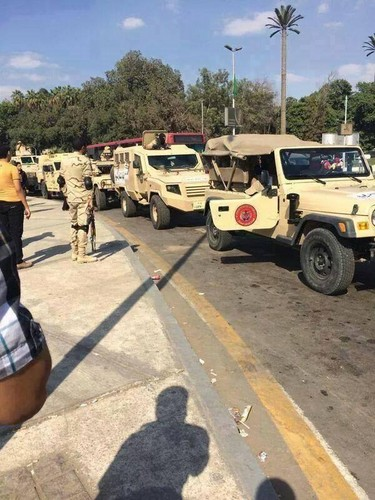 Egypt achtergrond probably with a humvee entitled ARMY EGYPT KILL EGYPT PEOPLE