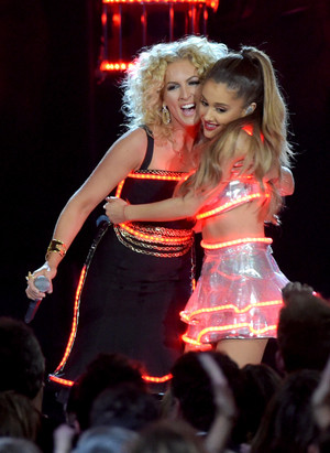 Ariana Grande and Little Big Town's Karen Fairchild performing at the 48th annual CMA Awards