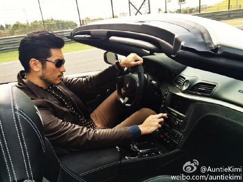 Godfrey Gao achtergrond probably containing an automobile titled Godfrey for Maserati