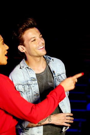 Louis mentoring On the X Factor