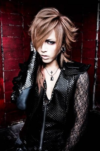 Nocturnal Bloodlust Hintergrund probably containing a well dressed person and a portrait called Masa