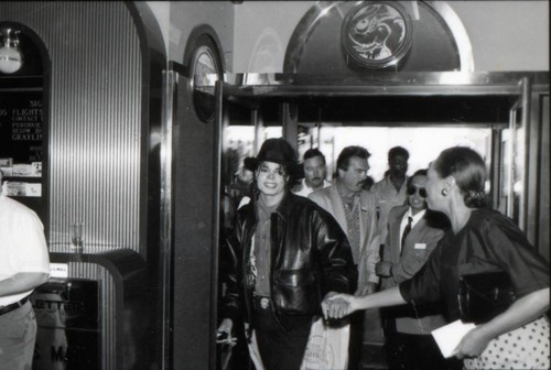 Michael Jackson wallpaper with a revolving door, a diner, and a street called Michael Jackson