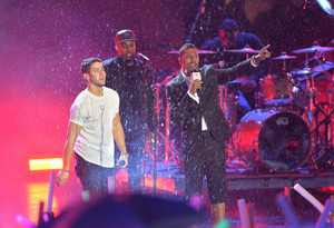 Nick Jonas performs in the rain on stage during the 2014 mtv EMA Kick Off at the Klipsch Amphitheate