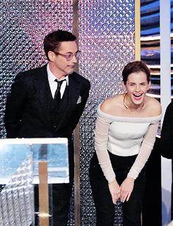 Robert Downey Jr karatasi la kupamba ukuta with a chainlink fence and a business suit entitled Robert Downey Jr and Emma Watson @ BAFTA LA Britannia Awards 2014 10/30