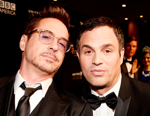 Robert Downey Jr. looking happy and cute with an assortment of people at the 2014 Britannia Awards q