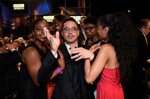 Robert Downey Jr. looking happy and cute with an assortment of people at the 2014 Britannia Awards