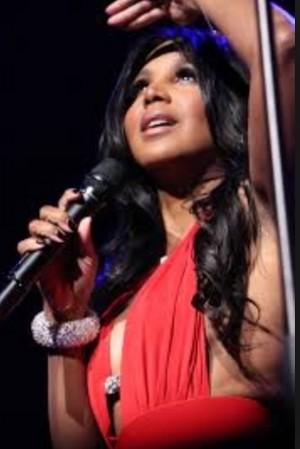 Toni Braxton wearing red