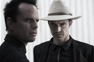 Walton Goggins as Boyd Crowder and Timothy Olyphant as Raylan Givens in Justified
