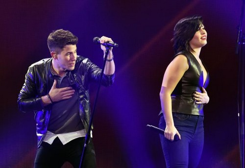 Nick Jonas karatasi la kupamba ukuta probably with a tamasha entitled DECEMBER 5th - Demi Lovato performing at 102.7 KIIS FM's Jingle Ball in Los Angeles, CA.