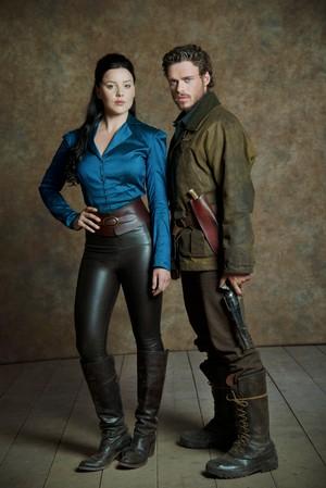 Abbie Cornish as Belinda Mulrooney and Richard Madden as Bill Haskell