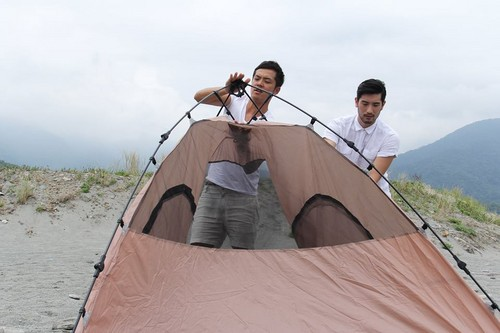 Godfrey Gao achtergrond with a mountain tent, a backpacking tent, and a two man tent entitled Love, Travel and Life