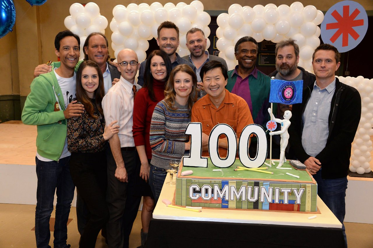 Paget and the Community Cast celebrate Episode 100