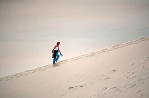 Woman Climbing Dune