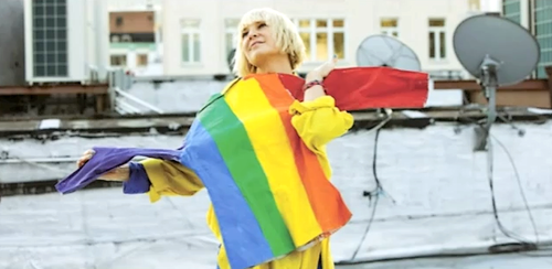 Sia fondo de pantalla probably containing a calle entitled sia furler arco iris