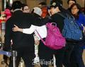 141219 ICN airport - sungmin and kim sa eun coming back from their honeymoon - super-junior photo