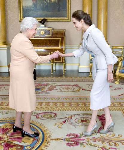 Queen Elizabeth II wallpaper possibly containing a sign entitled Angelina Jolie meets the Queen at Buckingham Palace