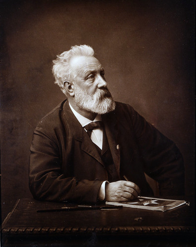Poets & Writers fond d'écran possibly containing a business suit titled Jules Verne in 1892