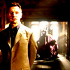 Liam Neeson litrato with a business suit called Ra's Al Ghul