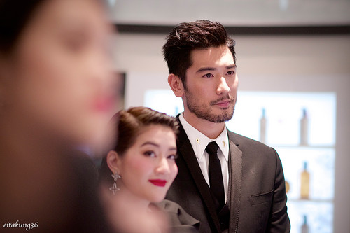 Godfrey Gao achtergrond containing a business suit, a suit, and a three piece suit called SK - II event