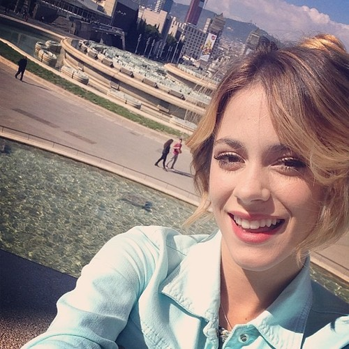Violetta wallpaper containing a business district and a portrait entitled tini stoessel