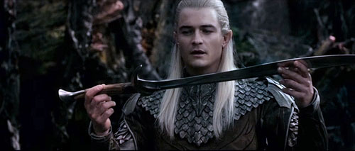 Legolas Greenleaf wallpaper probably with a tabard and a surcoat entitled Legolas with Orcrist