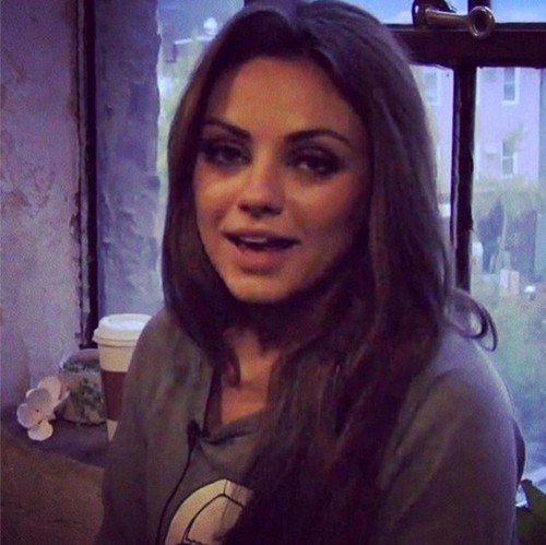 Mila Kunis kertas dinding with a portrait titled Mila