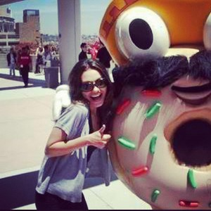 Mila posing with a donut
