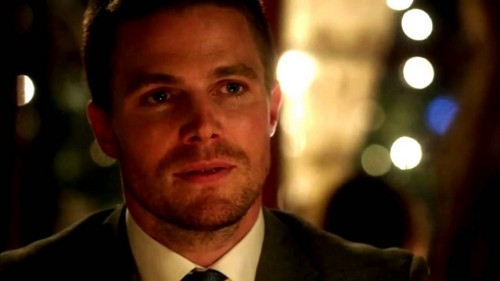 텔레비전 커플 바탕화면 with a business suit and a suit called Oliver and Felicity