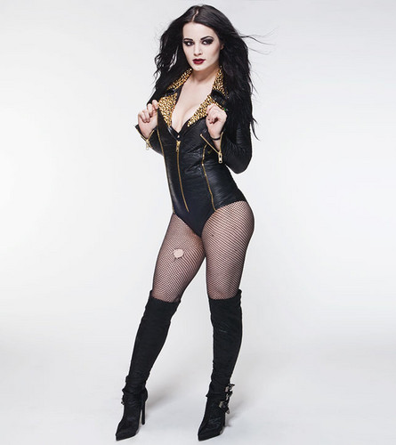 WWE Divas achtergrond possibly containing bare legs, tights, and a hip boot titled Paige Goes Glam