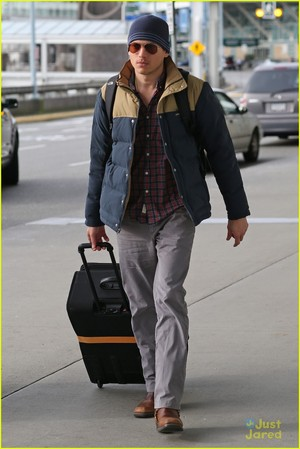 at the airport on Wednesday (January 21) in Vancouver, Canada.