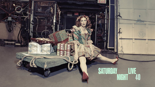 Amy Adams karatasi la kupamba ukuta possibly with a green beret, a street, and a sign called Amy Adams Hosts SNL: December 20, 2014