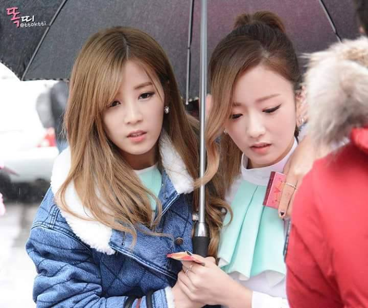 Chorong and Bomi Sharing an Umbrella