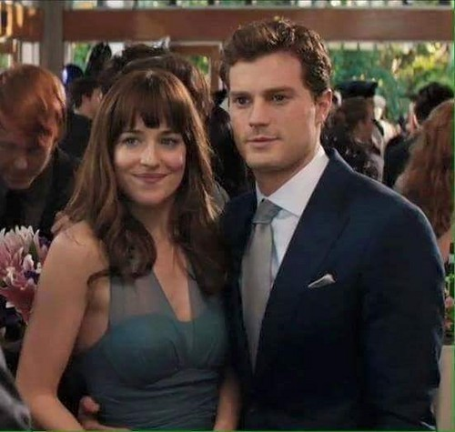 Fifty Shades-Trilogie Hintergrund containing a business suit entitled Christian and Anastasia