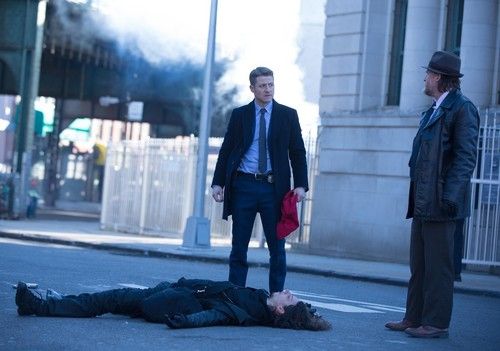 Gotham wallpaper with a business suit, a street, and a well dressed person titled Gotham - Episode 1.17 - Red Hood