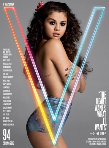 Selena Gomez پیپر وال titled Selena Gomez poses topless on V Magazine talks 'first love' Justin Bieber