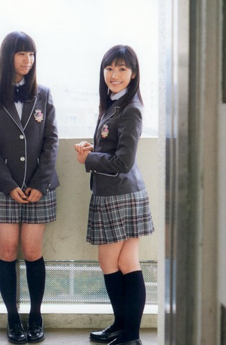 Watanabe Mayu 壁紙 possibly with bare legs, hosiery, and a hip boot entitled 渡辺麻友「制服図鑑 最後の制服」