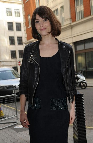 Gemma Arterton wallpaper possibly containing a well dressed person, a business suit, and an outerwear entitled Gemma Arterton