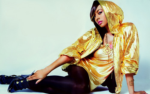 Keri Hilson wallpaper probably containing a hip boot, a blouse, and a playsuit titled Keri Hilson 2009
