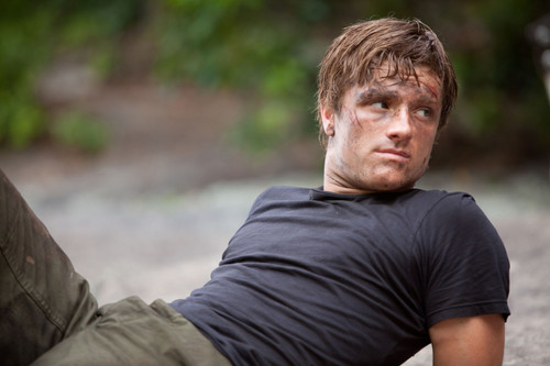 Peeta Mellark wallpaper probably containing a green beret, fatigues, and a rifleman called Peeta Mellark