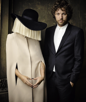 Sia and her husband photographed at the 2015 Vanity Fair Oscar Party