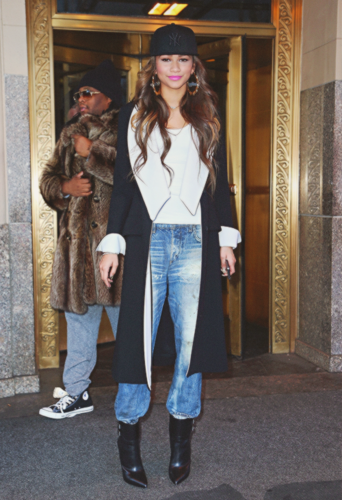 Zendaya Coleman wallpaper possibly containing a box coat, a business suit, and a fur coat titled Zendaya Coleman